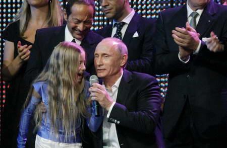 В. Путин с девочкой